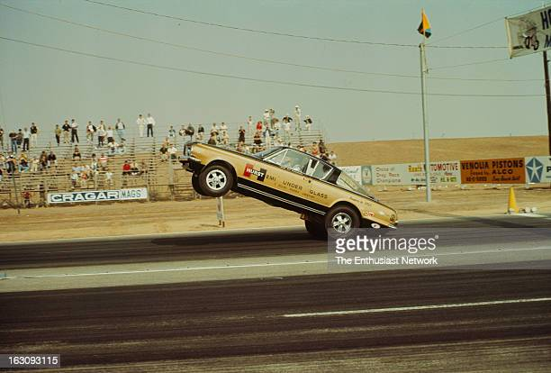 Hot Rod Magazine Championship Drags Riverside International Raceway The Hurst Hemi Under Glass Barracuda about to lift the front wheels off the...