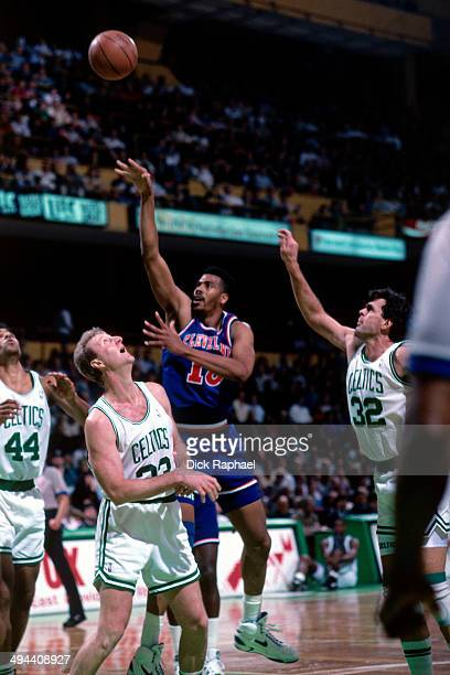 Hot Rod Williams of the Cleveland Cavaliers shoots against Larry Bird of the Boston Celtics during a game played in 1992 at the Boston Garden in...
