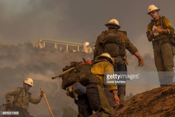 Hot Shot crew climbs a hill while cutting a line among homes at the Thomas Fire on December 16 2017 in Montecito California The National Weather...