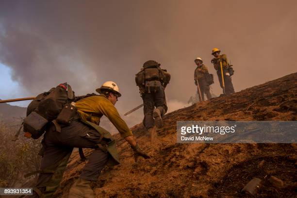 Hot Shot crew climbs a steep hill while cutting a line among homes at the Thomas Fire on December 16 2017 in Montecito California The National...