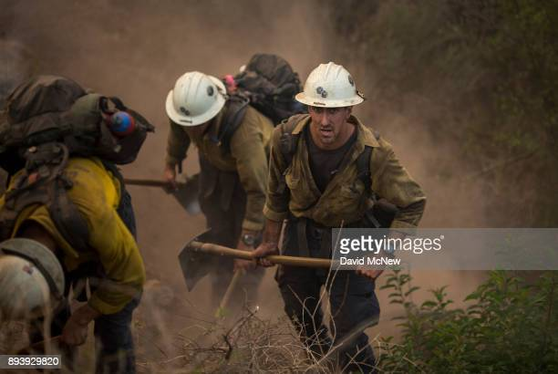 Hot Shot crew cuts a line among homes at the Thomas Fire on December 16 2017 in Montecito California The National Weather Service has issued red flag...