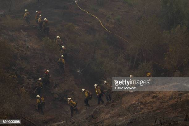 Hot Shot crew marches through a canyon between homes to fight the Thomas Fire on December 16 2017 in Montecito California The National Weather...