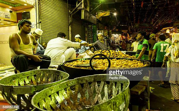 Hot snacks are prepared at a road side shop in the concluding night of Eid-ul-Fitr festival at Delhi. Eid-ul-Fitr, popularly known as Eid, is...