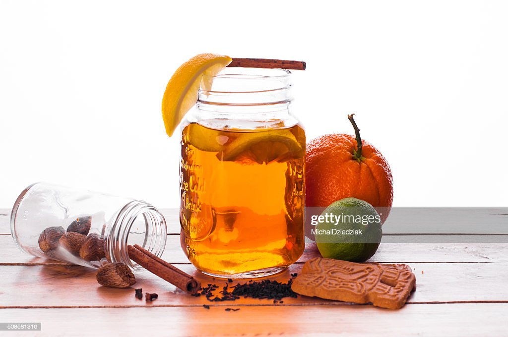 Hot spiced tea in jar on wooden table : Stock Photo