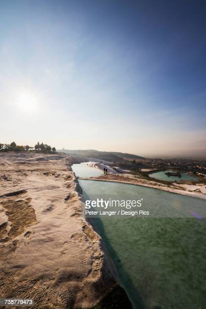 hot springs and travertines, terraces of carbonate minerals, pamukkale - hot women pics ストックフォトと画像