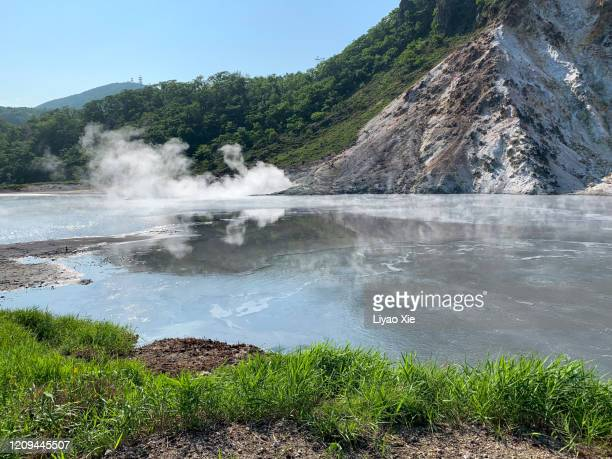 hot springs source - liyao xie stock pictures, royalty-free photos & images