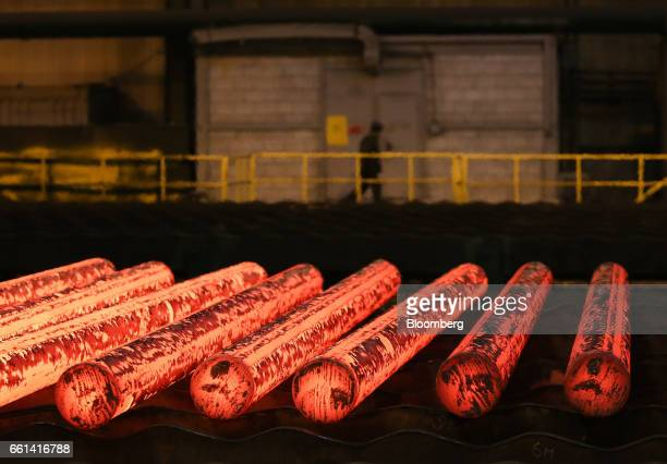 Hot steel billets used for production of seamless pipes roll along the production line in the electric steelmaking shop at the Volzhsky Pipe Plant...