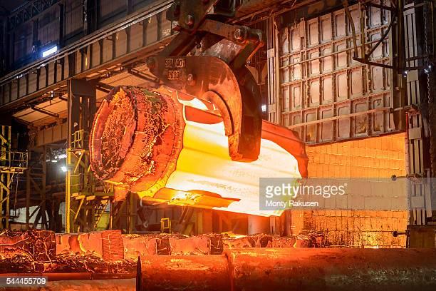 Hot steel casting in furnace in steelworks
