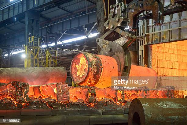 Hot steel casting on crane in steelworks