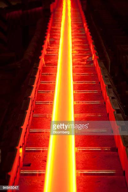 A hot steel Hbeam moves down the production line at the China Oriental Group Co steel plant in Tangshan Hebei province China on Saturday Aug 29 2009...