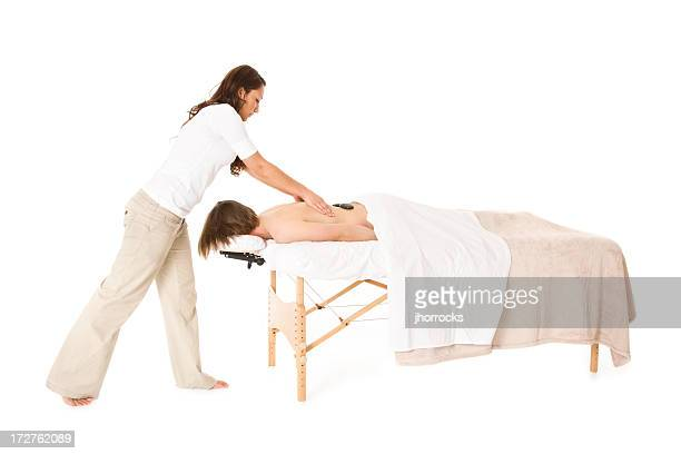 hot stone massage - black massage therapist stock photos and pictures