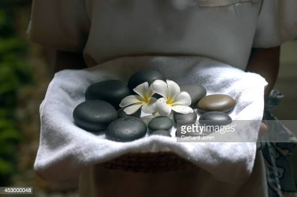 Hot stones are used to relax the muscles during a spa