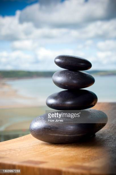 hot stones used for spa treatment - western europe stock pictures, royalty-free photos & images