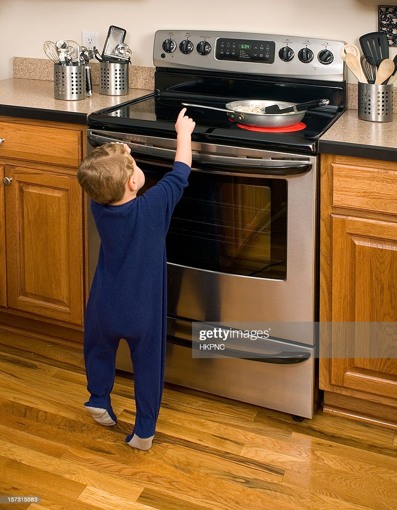 Hot Stove Danger Toddler Reaching Stock Photo Getty Images