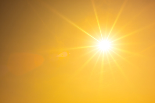 Hot summer or heat wave background, orange sky with glowing sun 993738504