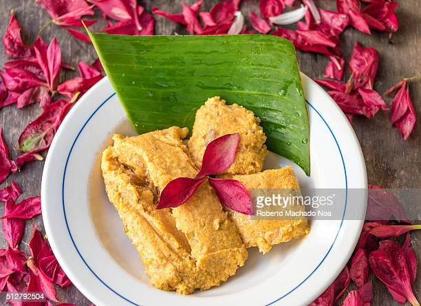 Hot tamales decorated with with a banana leaf under Traditional Cuban tamale filled with pork and other types of spices and condiments like Onions...