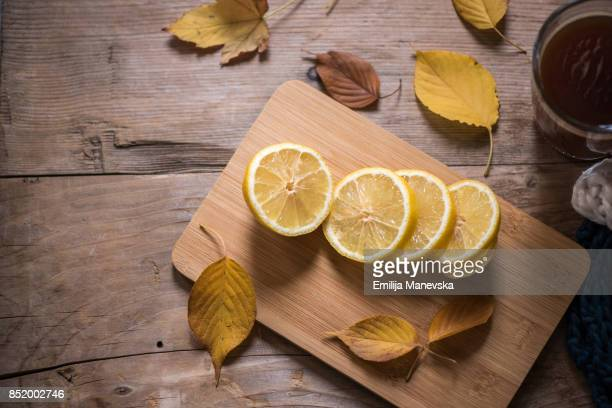Hot Tea and Lemon slices on wooden table