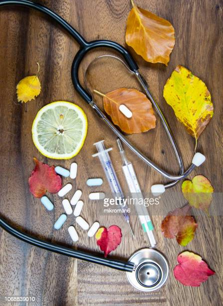 hot tea, capsules and pills and digital medical thermometer. medical concept - digital thermometer ストックフォトと画像