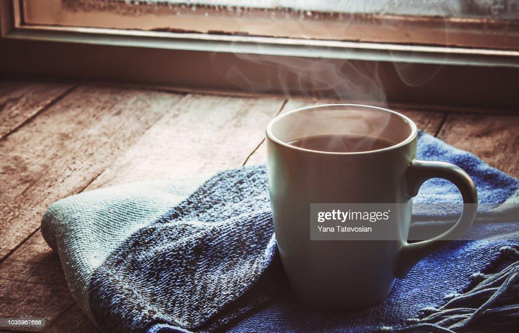 hot tea in the pot near the window. selective focus. : Stock Photo
