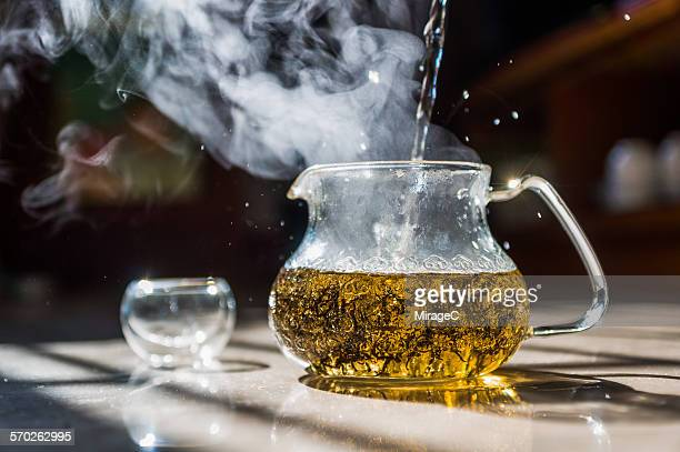 hot tea pouring - miragec stock pictures, royalty-free photos & images