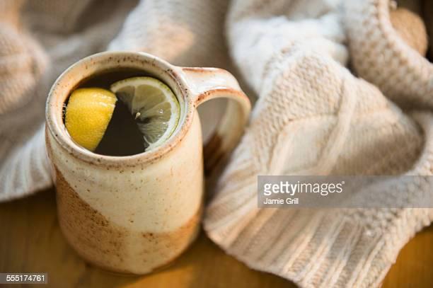 Hot tea with lemon slices