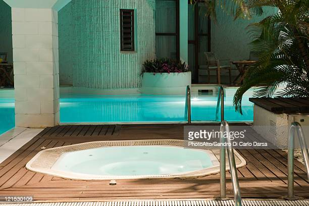 hot tub and swimming pool in hotel - health farm stock pictures, royalty-free photos & images