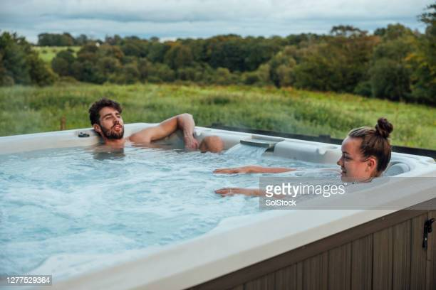 hot tub time - vacations stock pictures, royalty-free photos & images
