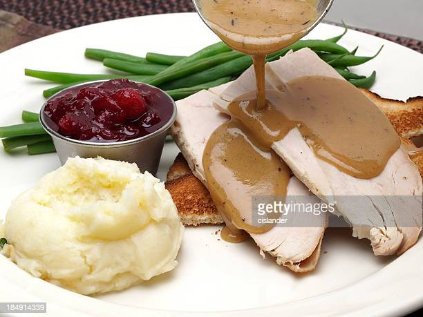 hot turkey sandwich - gravy stock photos and pictures