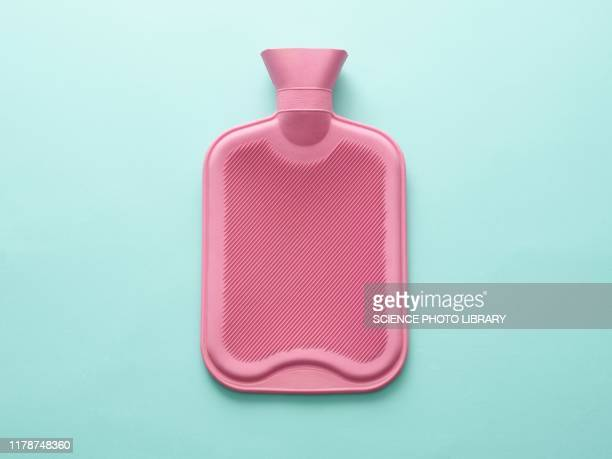 hot water bottle - man made object stock pictures, royalty-free photos & images