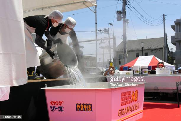 Hot water is poured onto the yakisoba noodles at Isesaki Station on May 5 2019 in Isesaki Gunma Japan The finished product cooked with 480 liters of...