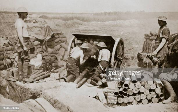 Hot work at the guns' Somme campaign France World War I 1916 British gunners busily engaged in putting over a curtain barrage Artist Unknown