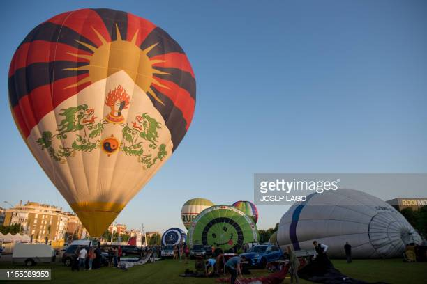 A hotair balloon flies during the 23th European Balloon Festival in Igualada near Barcelona on July 11 2019 The European Balloon Festival is the...