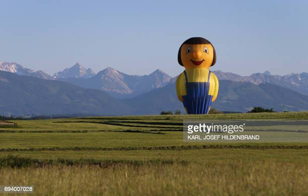 A hotair balloon in the form of a craftsman lands on June 8 2017 in Aitrang southern Germany / AFP PHOTO / dpa / KarlJosef Hildenbrand / Germany OUT