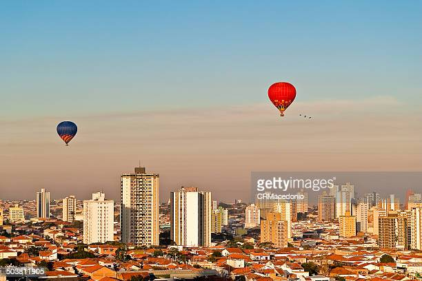 hot-air balloon over piracicaba - crmacedonio stock photos and pictures