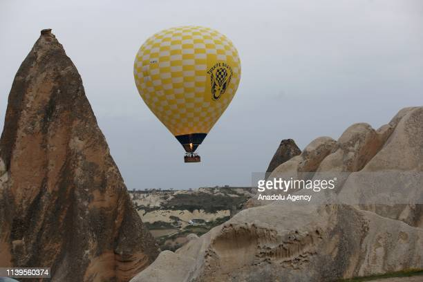 Hot-air balloon rides above fairy chimneys in the historical Cappadocia region, located in Central Anatolia's Nevsehir province, Turkey on April 27,...