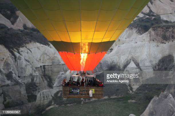 Hot-air balloon takes off to ride above fairy chimneys in the historical Cappadocia region, located in Central Anatolia's Nevsehir province, Turkey...