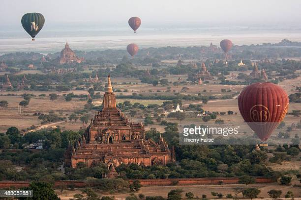 Hotair balloons fly at dawn over the Bagan archaeological site