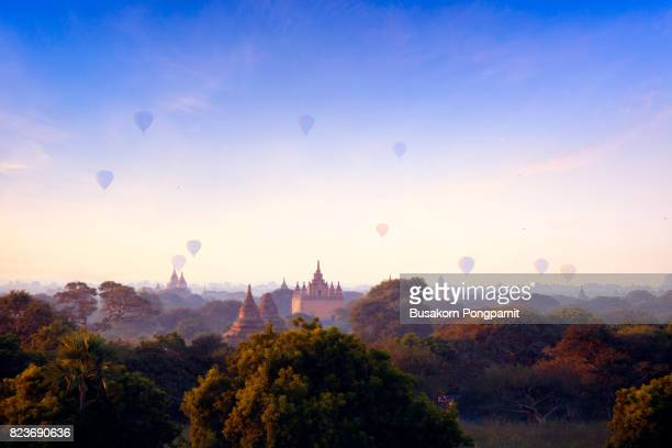 hot-air balloons flying over ananda temple at early morning, bagan, myanmar - myanmar culture stock photos and pictures