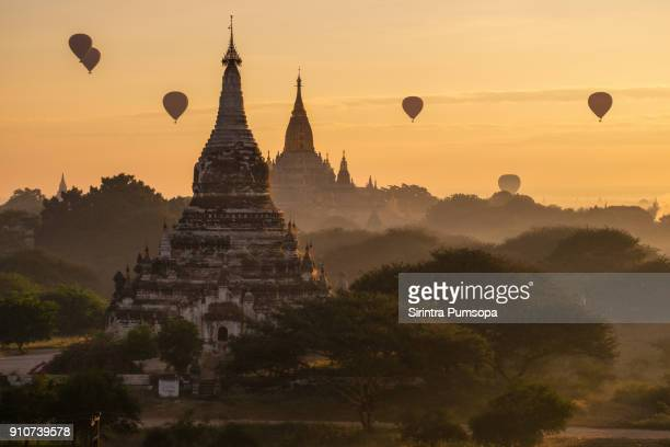 hot-air balloons flying over ananda temple at early morning, bagan, myanmar - association of southeast asian nations stock pictures, royalty-free photos & images