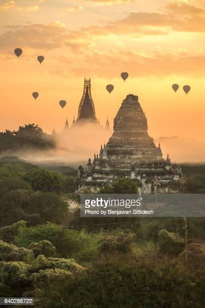 Hot-air balloons flying over pagodas in Bagan, Mandalay, Myanmar