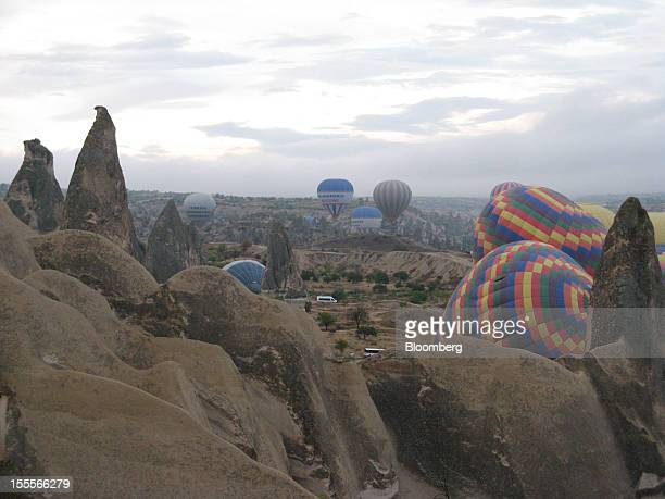 Hotair balloons stand in Cappadocia Turkey on Thursday Oct 11 2012 The bizarre rock formations typical of this volcanic region are known as 'fairy...