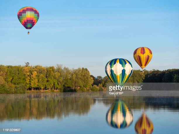 hot-air balloons touching water northwest art air festival albany oregon - august stock pictures, royalty-free photos & images