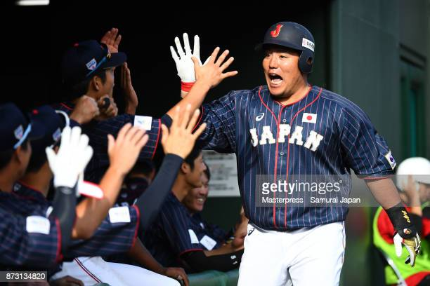 Hotaka Yamakawa of Samurai Japan celebrates after hitting a home run during the practice game between Japan and Hokkaido Nippon Ham Fighters at...