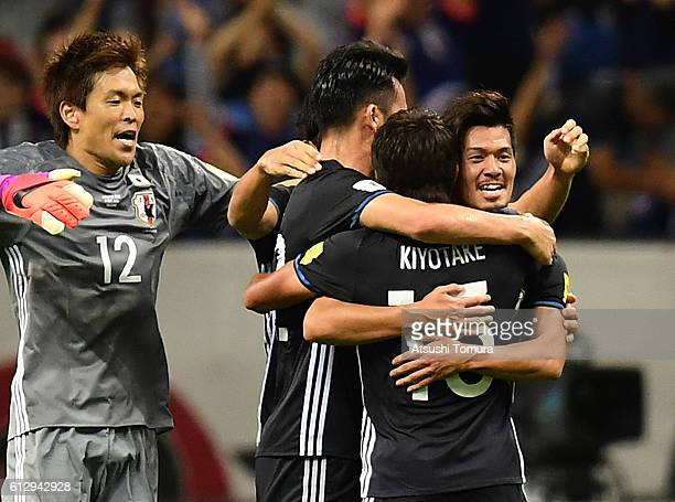 Hotaru Yamaguchi celebrates with his team after winning the 2018 FIFA World Cup Qualifiers match between Japan and Iraq at Saitama Stadium on October...