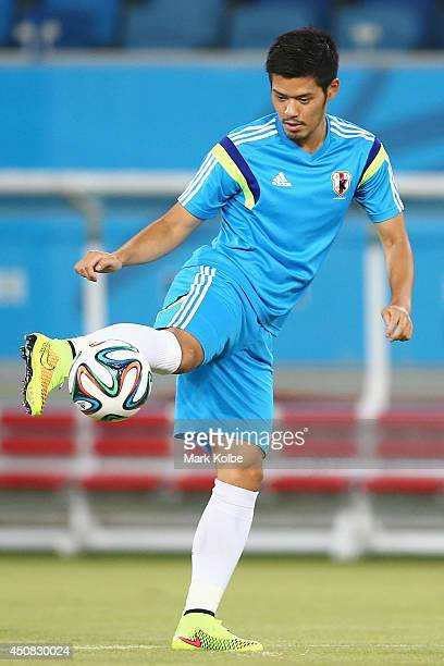 Hotaru Yamaguchi kicks during a Japan training session at the Dunas Arena in Natal on June 18 2014 in Natal Rio Grande do Norte
