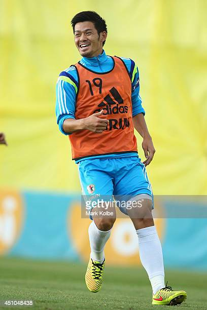 Hotaru Yamaguchi laughs during a Japan training session at the Japan national team base camp at the Spa Sport Resort on June 22 2014 in Itu Sao Paulo