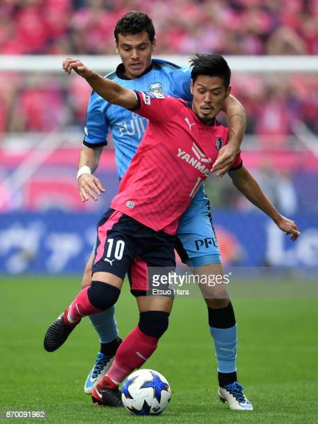 Hotaru Yamaguchi of Cerezo Osaka and Eduardo of Kawasaki Frontale compete for the ball during the JLeague Levain Cup final match between Cerezo Osaka...