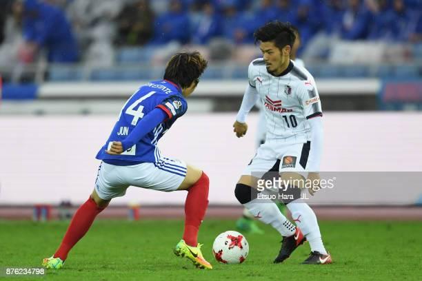 Hotaru Yamaguchi of Cerezo Osaka and Jun Amano of Yokohama FMarinos compete for the ball during the JLeague J1 match between Yokohama FMarinos and...