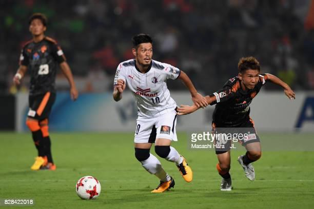Hotaru Yamaguchi of Cerezo Osaka and Shota Kaneko of Shimizu SPulse compete for the ball during the JLeague J1 match between Shimizu SPulse and...