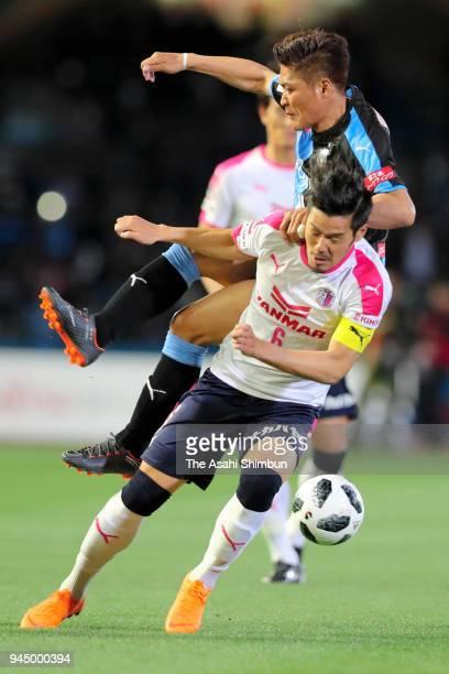 Hotaru Yamaguchi of Cerezo Osaka and Yoshito Okubo of Kawasaki Frontale compete for the ball during the JLeague J1 match between Kawasaki Frontale...